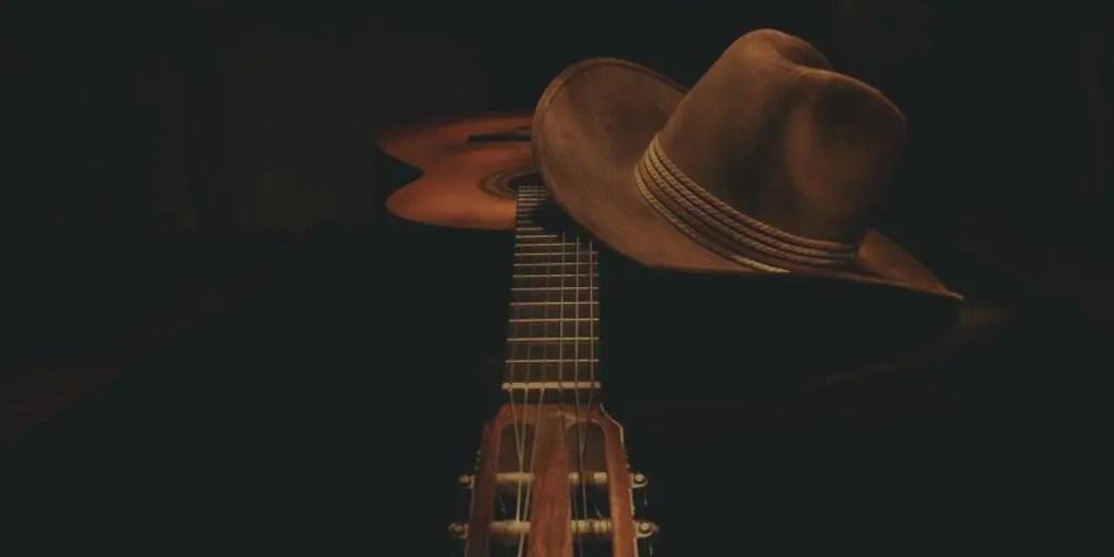 guitar and cowboy hat