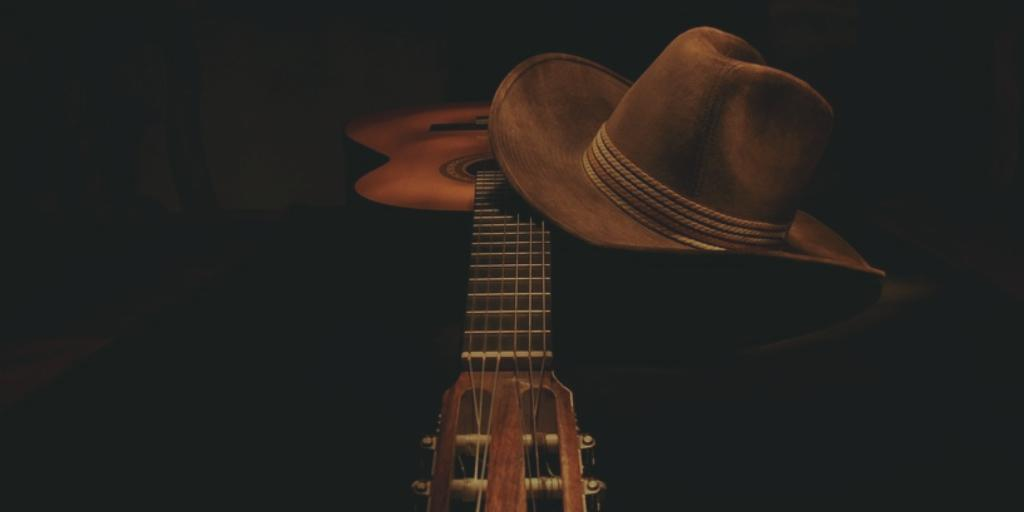 guitar and cowboy hat