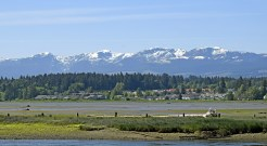 view from the shore across estuary during low tide, Courtenay Vancouver Island British Columbia Canada