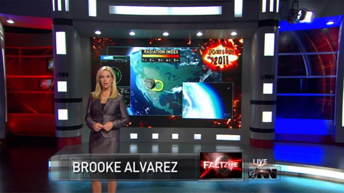 Scene showing news anchor Brooks Alvarez in front of countdown screen in The Onion News Network Asteroid Heads To Earth (2011)