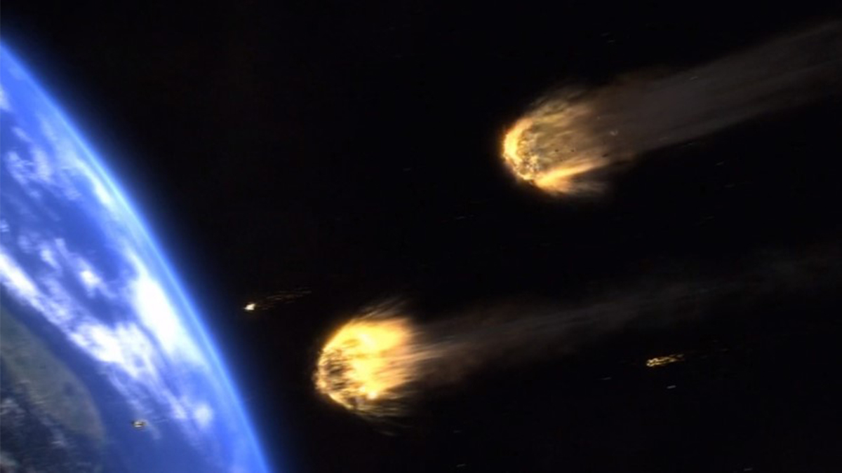 Scene from Meteor (2009) showing two meteoroids approaching Earth. In blog Making an Impact: Lights, Camera and Asteroid! a blog which is about asteroid impacts and comet impacts on Earth.