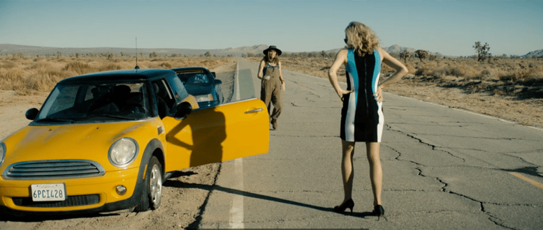 Violet meets Patty Solis-Papagian with Yellow Mini stranded on a desert highway.