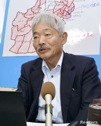 Tetsu Nakamura speaks at a meeting reporting about Afghanistan's draught problem in Fukuoka, Japan in this photo taken by Kyodo…