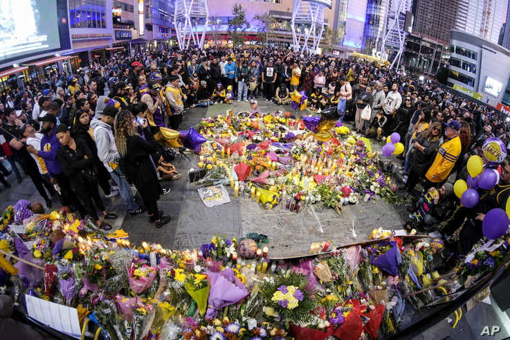 People gather at a memorial for Kobe Bryant near Staples Center Monday, Jan. 27, 2020, in Los Angeles. Bryant, the 18-time NBA…