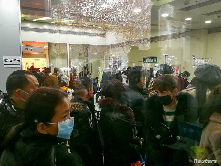 People queue for receiving treatment at the fever outpatient department at the Wuhan Tongji Hospital in Wuhan, Hubei province, China, Jan. 22, 2020.