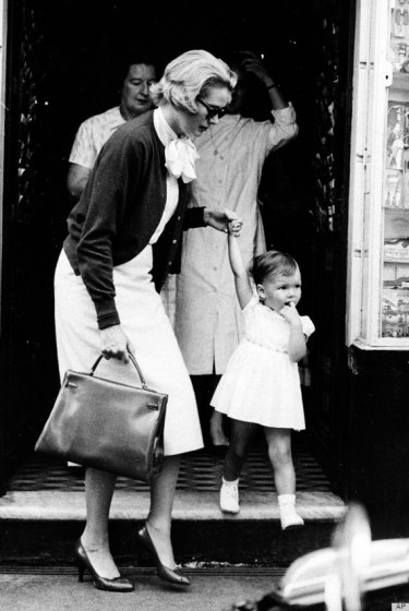Grace Kelly with daughter Princess Caroline in 1958. Exemplary chic mommy style.