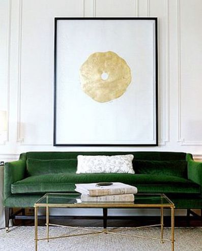 An emerald green sofa in mohair is the perfect pop of color for the neutral room. I love the clean lines of the brass cocktail table with the gold art above the sofa.