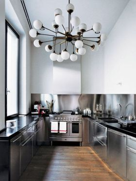 The bold chandelier completes the clean and contemporary kitchen.