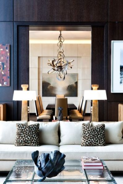 The sculptural chandelier above the dining table in the adjacent space is perfect for both rooms.