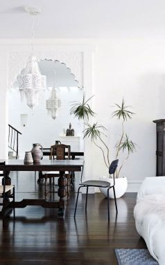 I love the use of Moorish lanterns and woodwork, the white washed look with the dark floors and simple furniture is a beautiful contrast.