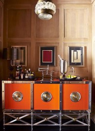 A sophisticated orange bar with bold unpolished nickel hardware makes quite a statement in this little nook