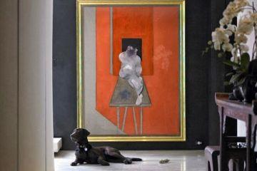 Designer Donna Karan pops orange in a painting in her chic Manhattan apartment