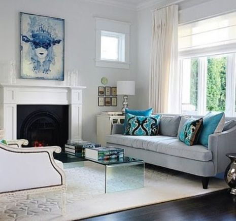 Combining modern art, rugs, and pillows into a traditional room instantly updates a classically designed space.