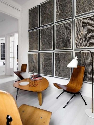 This block print gallery wall plays perfectly with the modernist organic furniture and the clean all white slate.