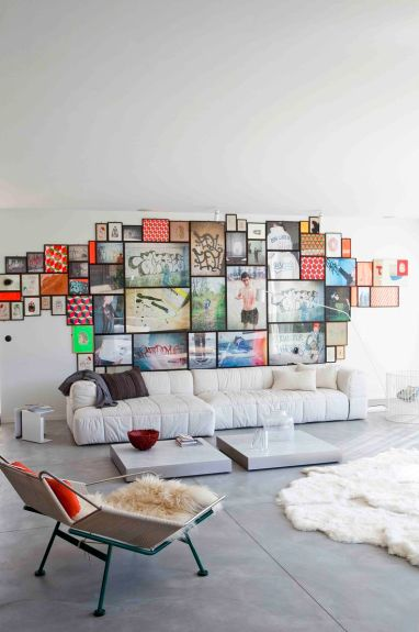 A whimsically fresh gallery wall in this playfully chic home.