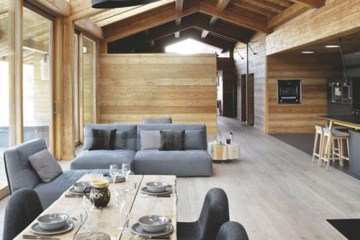 This chic chalet in the Alps is perfection and all about bringing the outdoors in with simple floor to ceiling windows. After all, the primary reason we escape to the mountains or country is to experience the great outdoors (from inside for some).