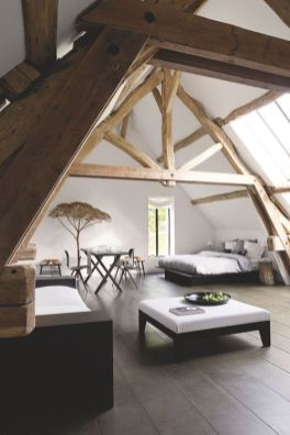 This loft suite with the wall of windows is the perfect solution for an otherwise small farm house or even an attic of a country home.