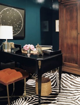 Burnt orange and teal create a memorable combination as in this classic office.