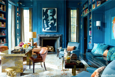 This bold drawing room in Chicago's Gold Coast in a brilliant blue boasts orange/gold accents - a very playful european combination