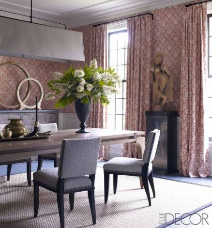 Adding a few pieces of ethnic art to this somewhat classic room is not only unexpected but it also adds an element of interest far greater than going all one style.