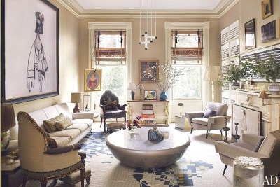 At first glance, this very sophisticated townhouse drawing room may appear simple. Take a closer look and notice the contemporary patterned rug that pulls together the eclectic collection of art and furniture.