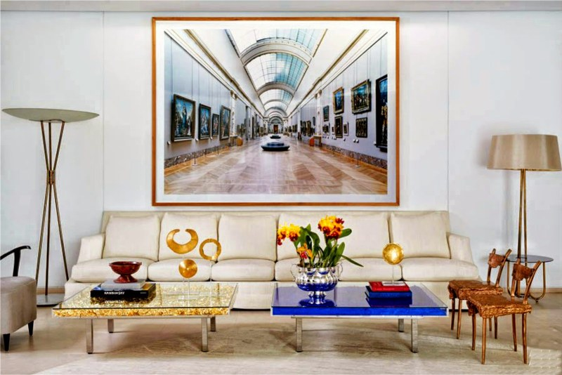 These chic avant-garde Yves Klein cocktail tables side by side make quite a bold color statement in the most subtle way in this wonderfully neutral room.