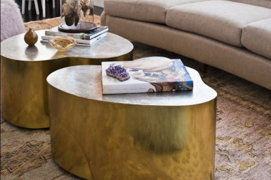 Artfully sculptural tables can make quite a statement in a classic room.