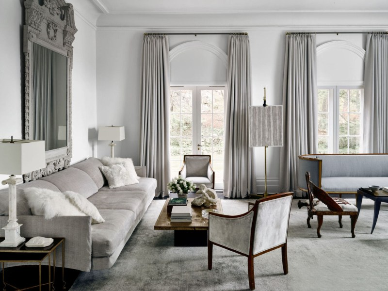 Very chic home of 1st Dibs founder Michael Bruno is Tuxedo Park is a study in shades of grey but most interesting is the LaVerne 'Chan' cocktail table in brass with chinoiserie.