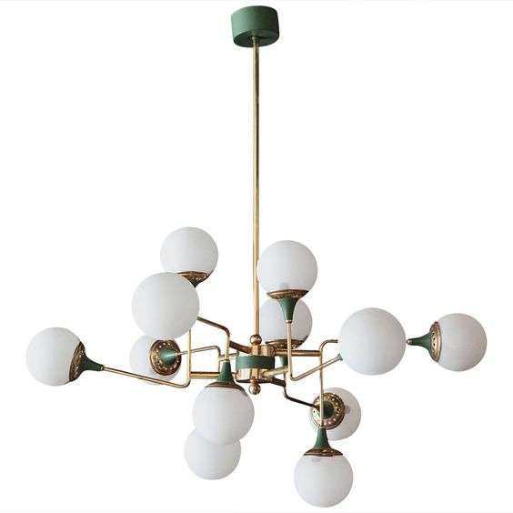 An incredible Stilnovo mid-century chandelier can make a room. We love the frosted glass with the patina arms and deep green enamel details.