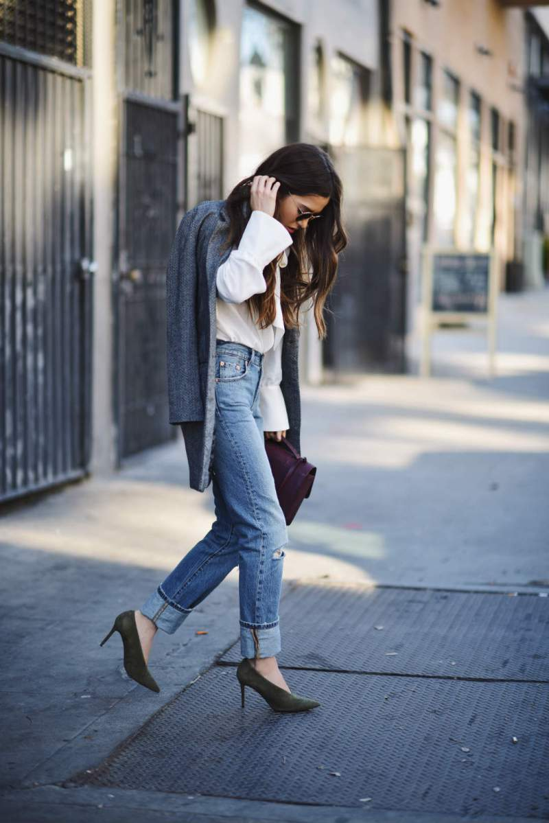 blank itinerary wears jeans to work, green heels and white shirt