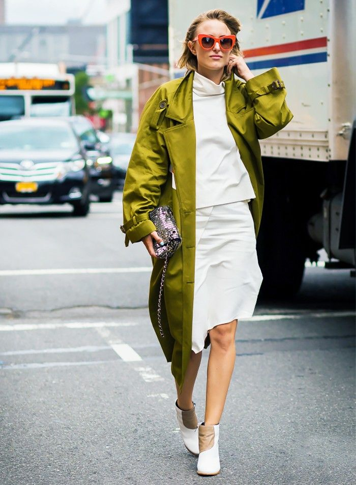 avant garde style type street style - blogger in a bright green trench coat, white two piece and white booties
