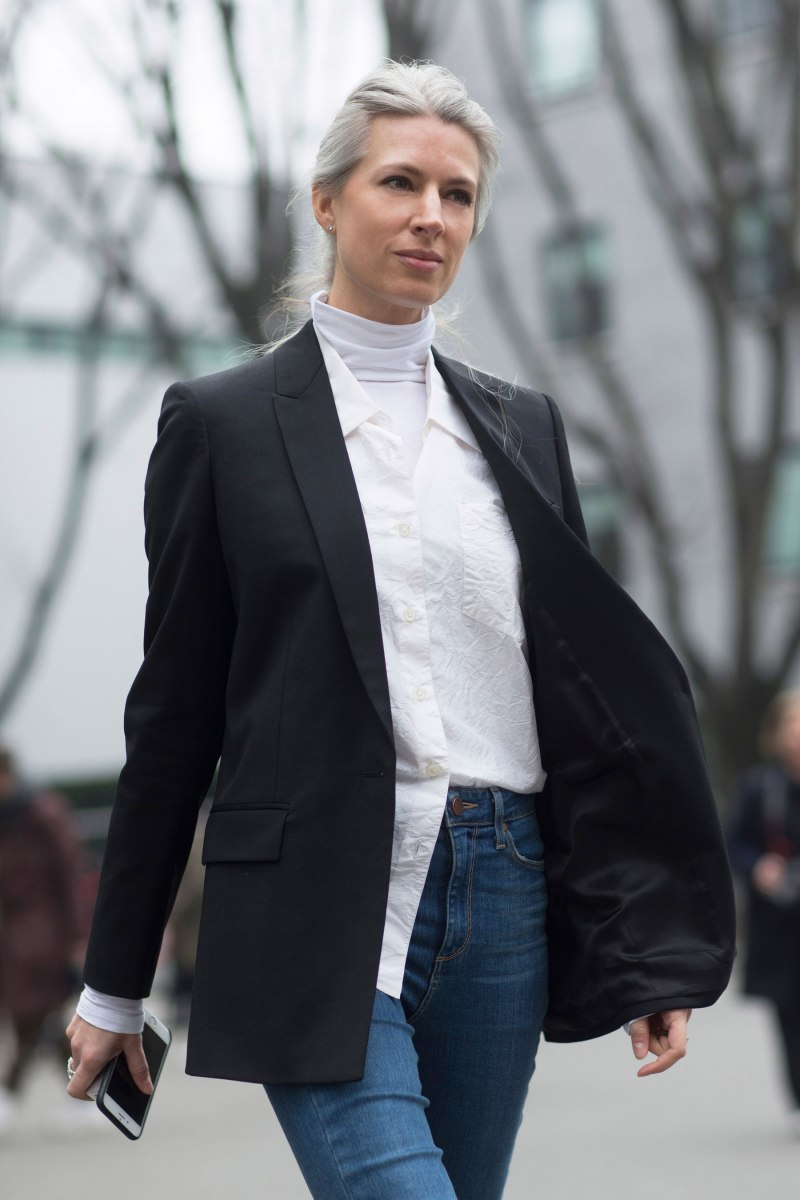 sarah harris in a classic look wearing a blazer and white button up