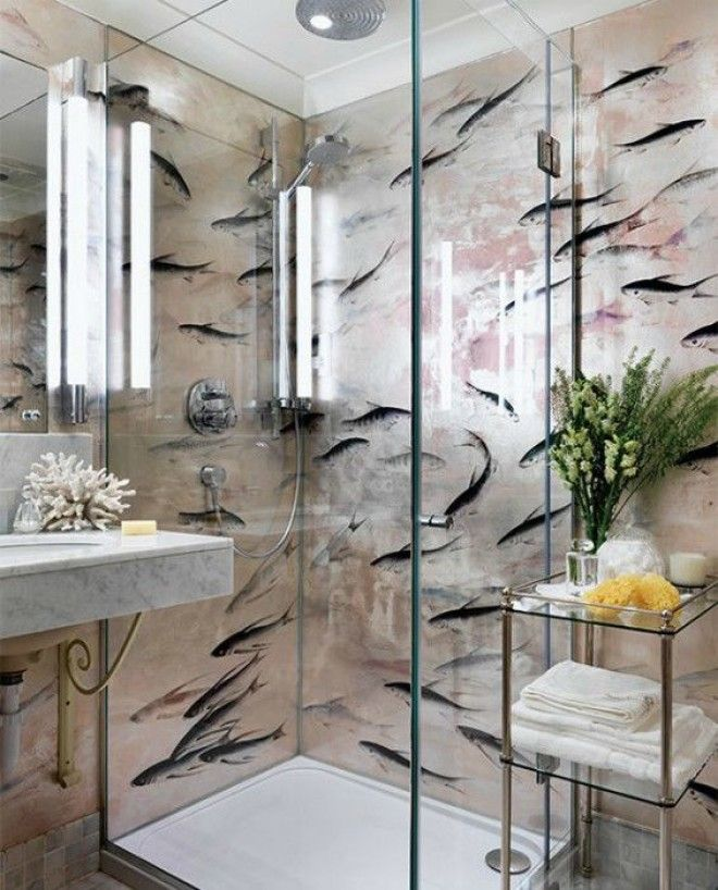 fish wallpaper in this small beach house bathroom