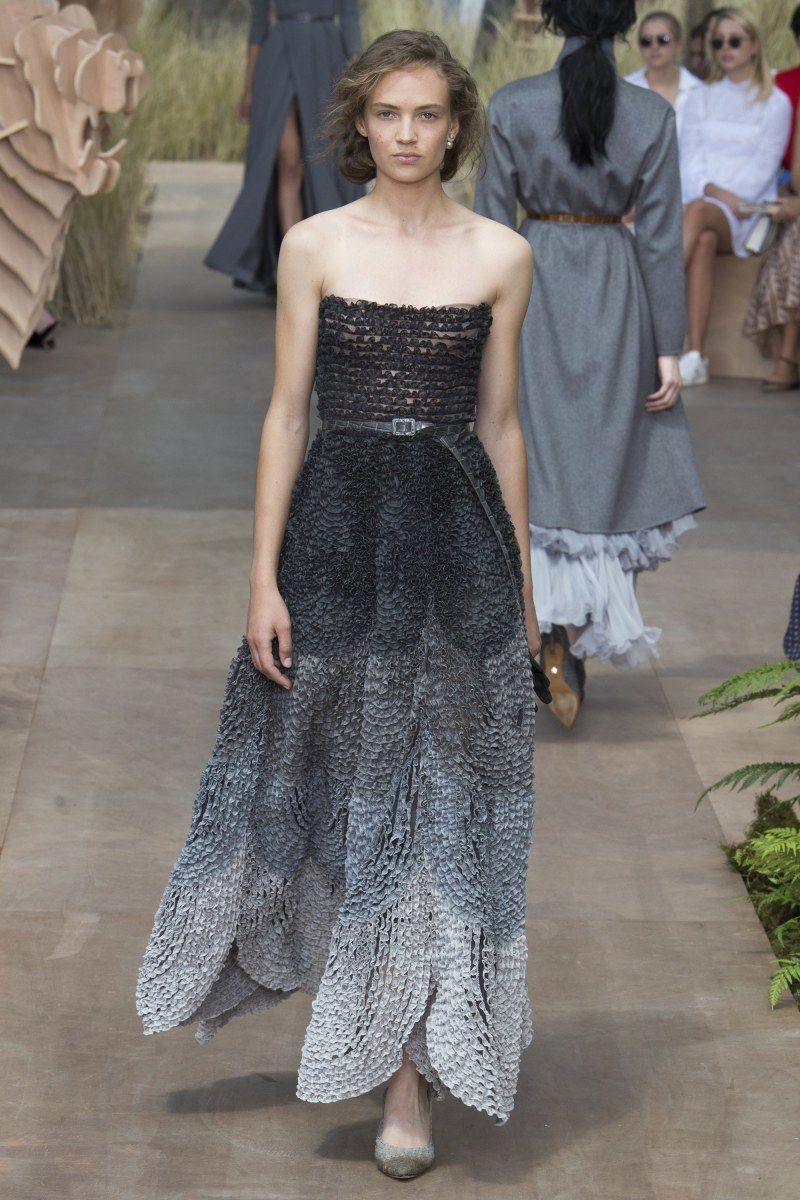 Model in dior ombre dress walking down runway at fall 2017 couture show