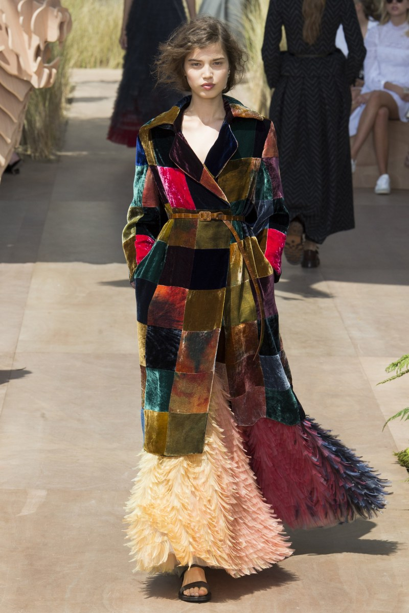 Model in dior patchwork dress walking down runway at fall 2017 couture show