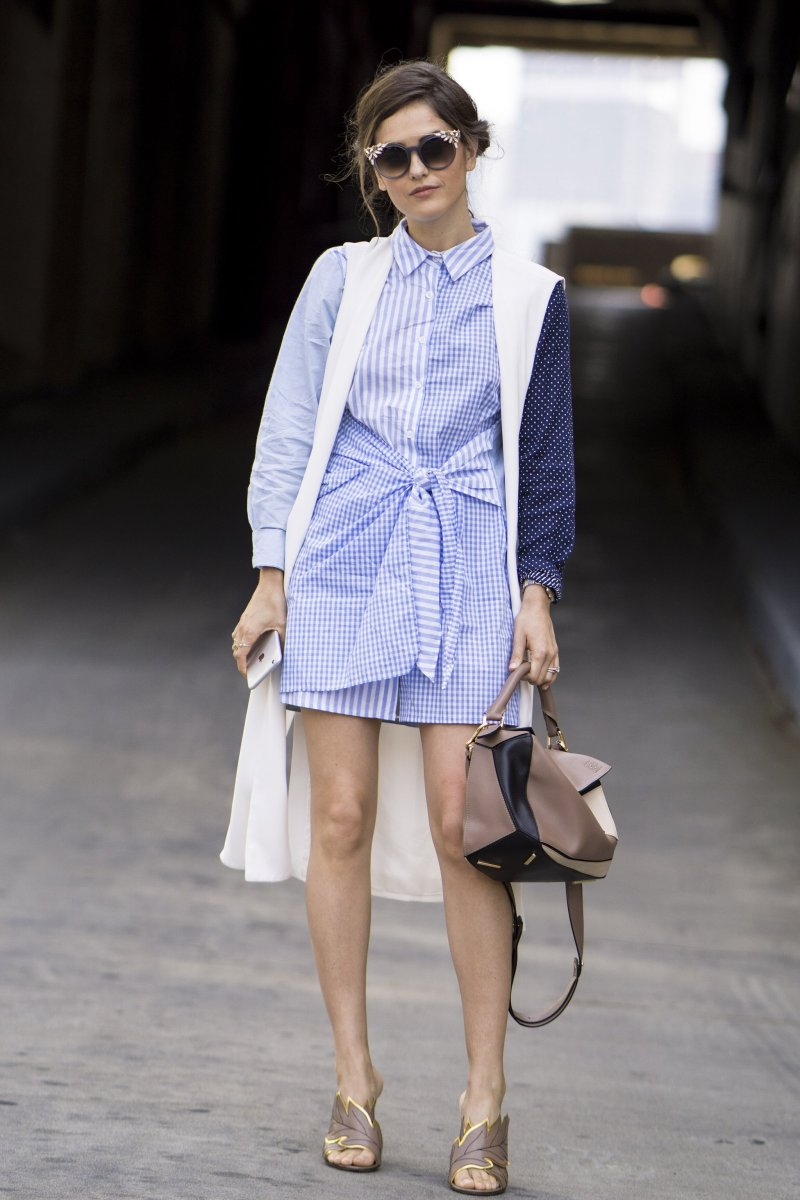 blank itinerary in a blue striped dress and patterned long kimono and loewe bag