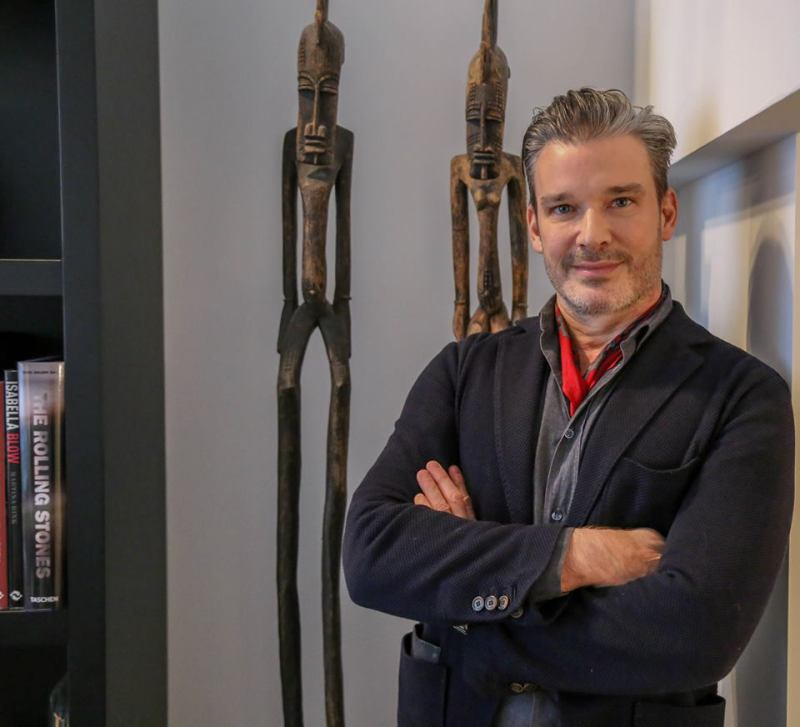 Interior designer joe lupo in front of two sculptures