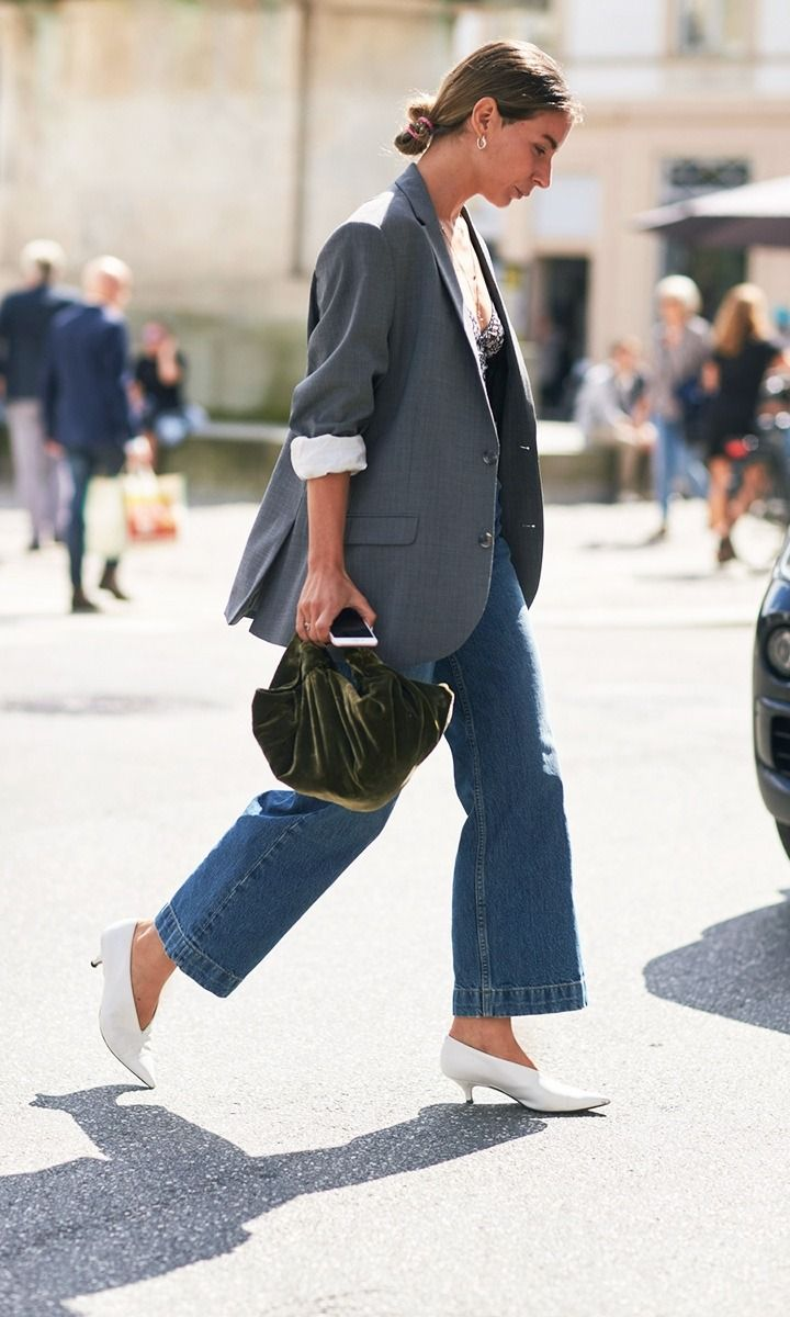 Street style photo of blogger in blazer and jeans