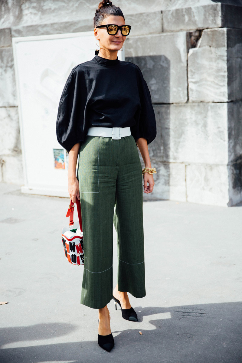 giovanna battaglia in a balloon sleeve black top and green pants