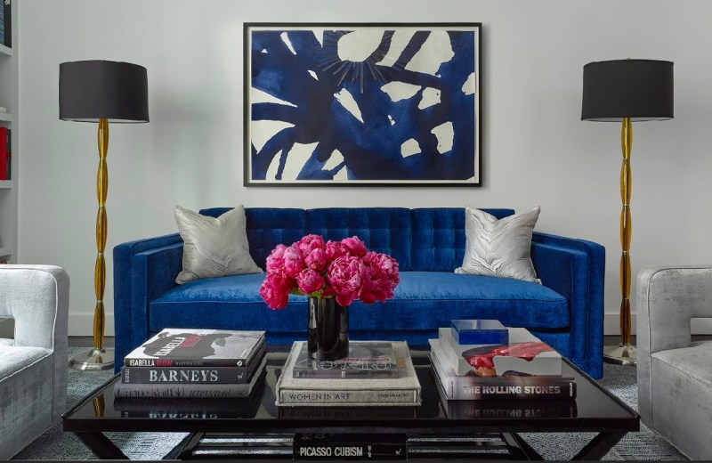 Cobalt sofa, pink peonies, coffee table, coffee table books