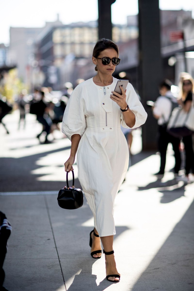 street style photo of blogger wearing balloon sleeve white dress
