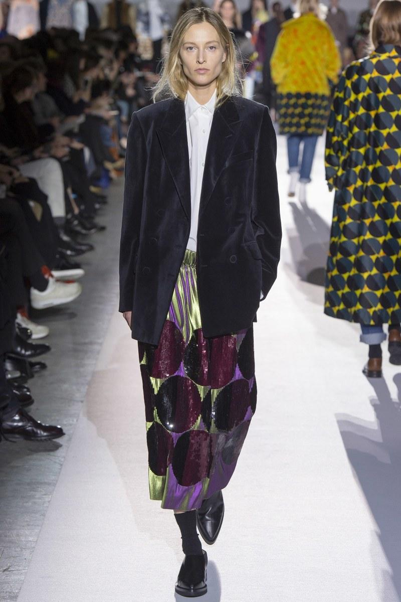 Model walks down runway in dries van noten geometric skirt