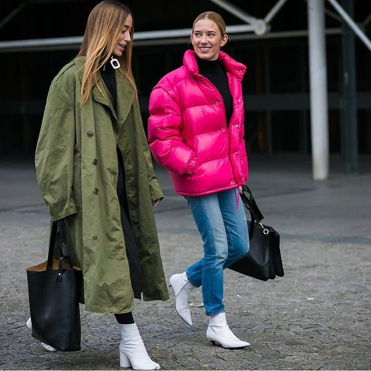 Georgina and demna in white booties, olive trench coat and punk puffer coat