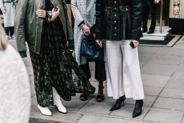 photo of three women with booties, skirts and pants