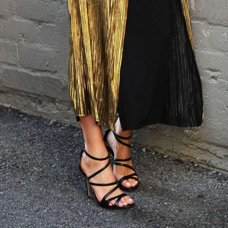 olivia culpo Strappy heels, black dress and gold kimono