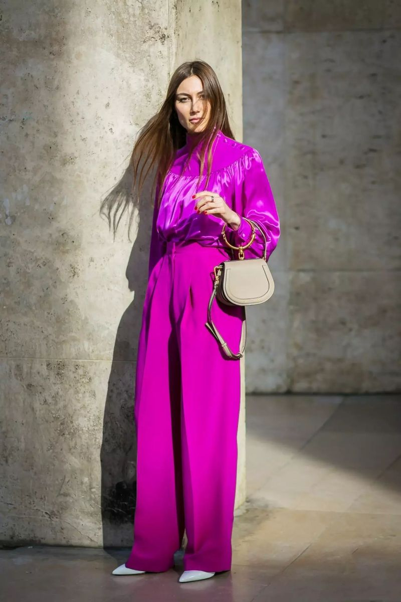 Giorgia Tordini in magenta silk top and pants with chloe bag
