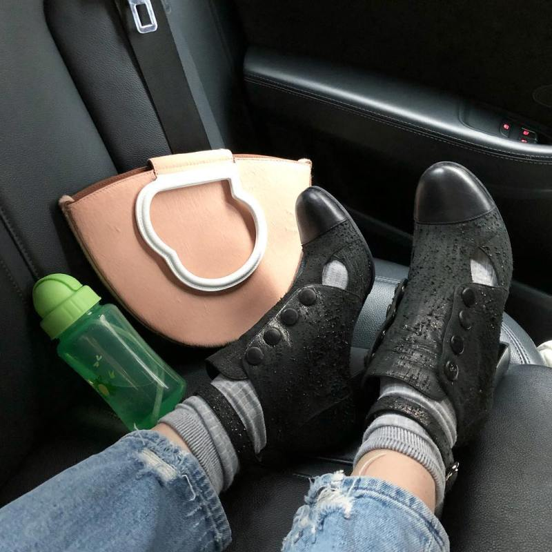 Eva Chen classic pose of Danse Lente bag and shoes on back seat of taxi