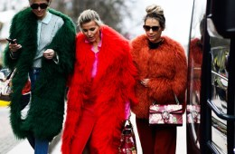 three street style bloggers at fashion week wearing red and green fur