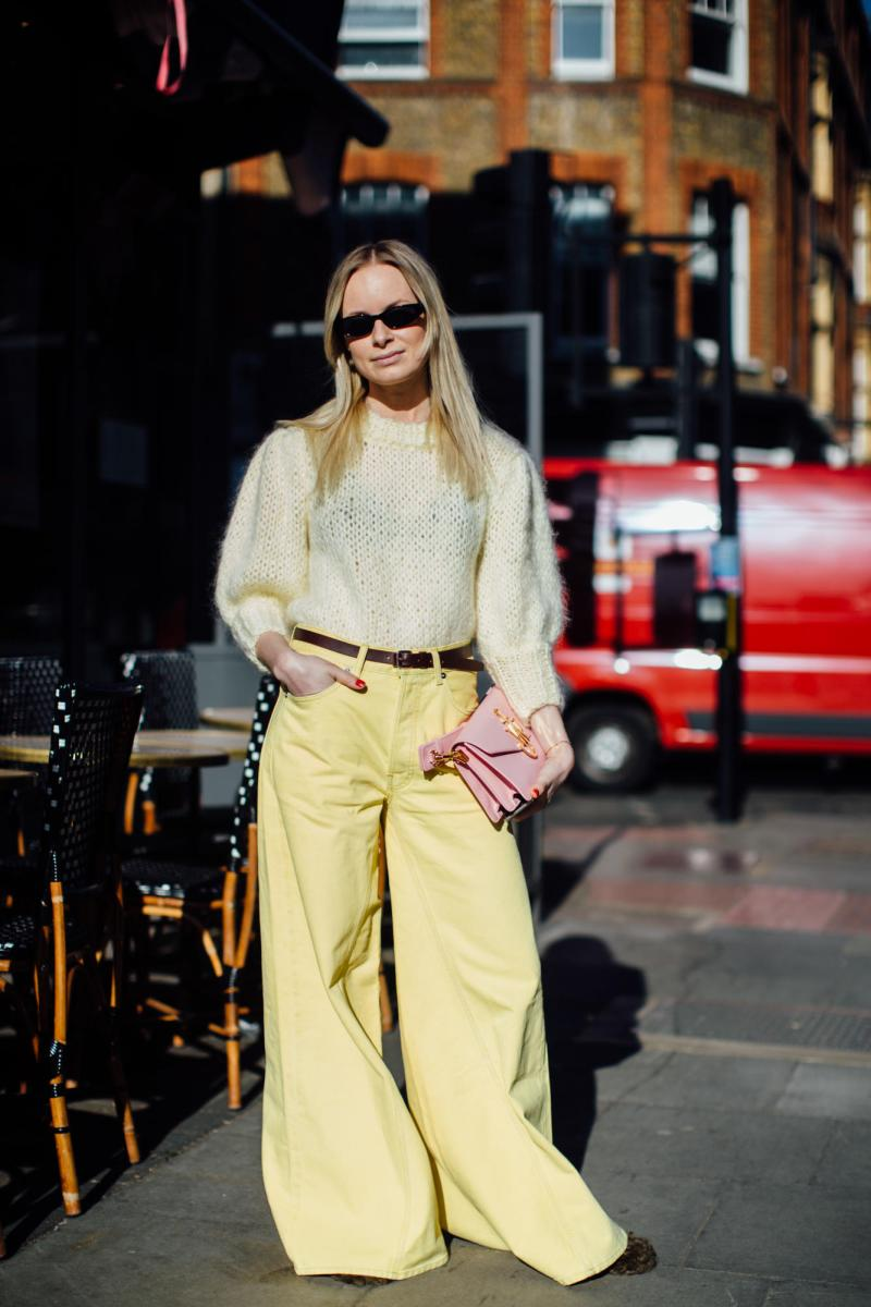 Street style shot of blogger attending london fashion week in yellow monochromatic outfit pants and shirt
