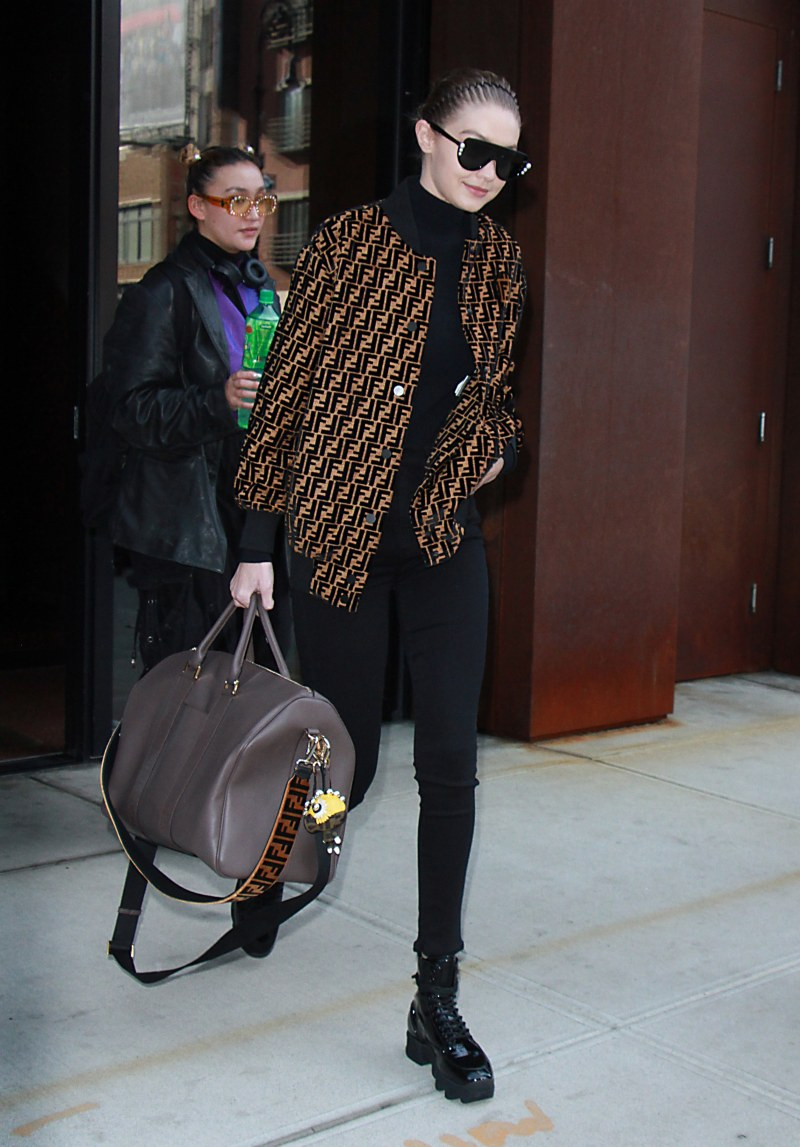gigi hadid in double F fendi logo jacket at the airport